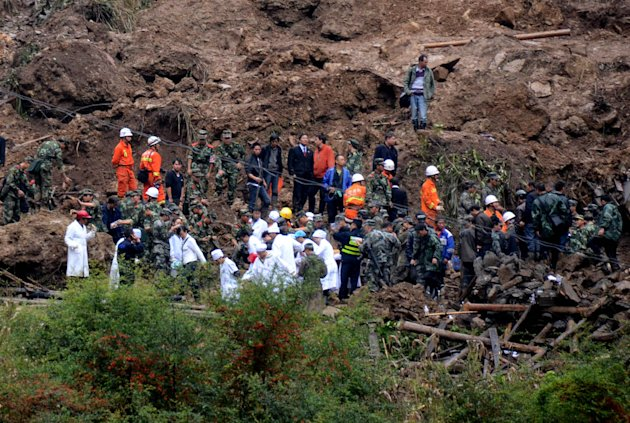 In this Thursday, Oct. 4, 2012 photo provided by China's Xinhua News Agency, rescuers search for victims where a landslide occurred in Yiliang County, southwest China's Yunnan Province. All 18 elementary school students buried in a landslide were confirmed dead Friday, while one other person remained missing a day after the hillside collapsed and smothered part of a village in mountainous southwestern China. (AP Photo/Xinhua, Yuan Zhengxiong) NO SALES