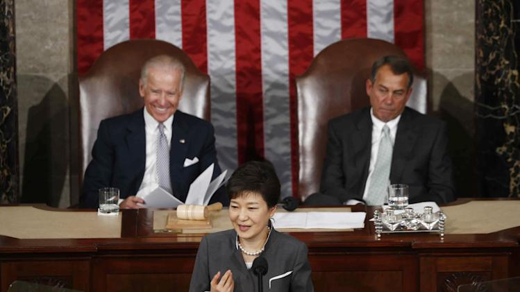 South Korea's President Park Geun-hye addresses a joint session of Congress on Capitol Hill in Washington, Wednesday, May 8, 2013. At rear are Vice President Joe Biden, left, and House Speaker John Boehner of Ohio. (AP Photo/Charles Dharapak)