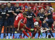 Liverpool's Steven Gerrard (C) takes a free kick during their English Premier League soccer match at Anfield, Liverpool, northern England September 1, 2013. REUTERS/Phil Noble
