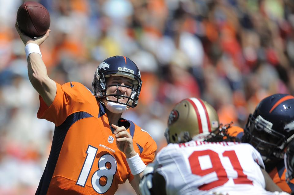 Denver Broncos quarterback Peyton Manning (18) passes against the San Francisco 49ers during the first quarter of an NFL preseason football game in Denver, Sunday, Aug. 26, 2012. (AP Photo/Jack Dempsey)