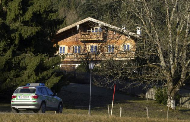A police car drives in front of the house belonging to Bayern Munich President Uli Hoeness in Bad Wiessee