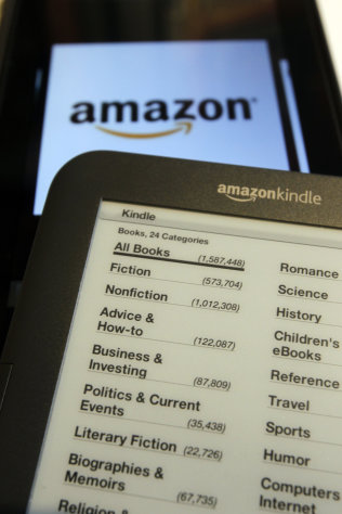 An Amazon Kindle, bottom, and a Kindle Fire are displayed on Monday, Oct. 15, 2012 in Montpelier, Vt. Kindle readers may soon get a refund. Amazon has alerted its Kindle customers that they are entitled to a credit on prior electronic book purchases as part of a legal settlement.(AP Photo/Toby Talbot)