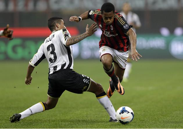 AC Milan's Robinho gets the ball past Udinese defender Allan Loureiro Marquez of Brazil, during a Serie A soccer match between AC Milan and Udinese, at the San Siro stadium in Milan, Italy, Saturday,