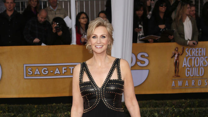 Jane Lynch arrives at the 19th Annual Screen Actors Guild Awards at the Shrine Auditorium in Los Angeles on Sunday Jan. 27, 2013. (Photo by Todd Williamson/Invision for The Hollywood Reporter/AP Images)