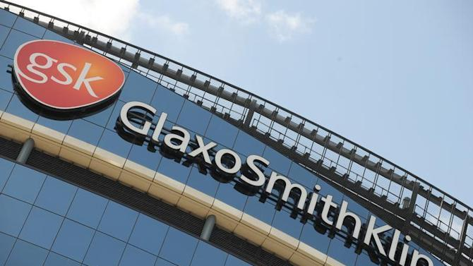 Signage is pictured on the company headquarters of GlaxoSmithKline in west London