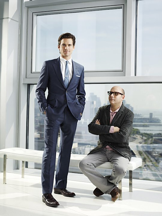 "Matt Bomer as Neal Caffrey, Willie Garson as Mozzie in ""White Collar."""