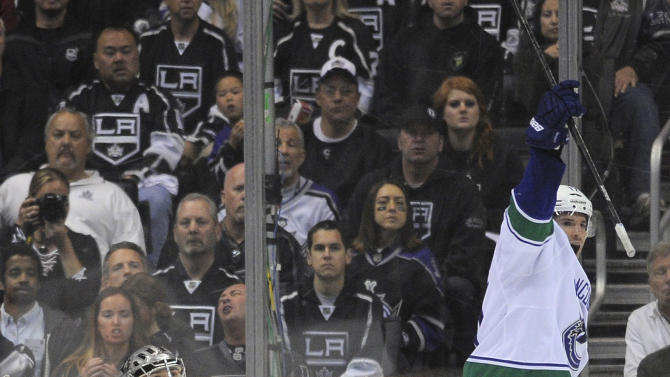 Vancouver Canucks center Ryan Kesler, right, celebrates a goal by Alexander Edler as Los Angeles Kings goalie Jonathan Quick looks up during the second period of Game 4 in a first-round NHL Stanley Cup playoff series, Wednesday, April 18, 2012, in Los Angeles. (AP Photo/Mark J. Terrill)