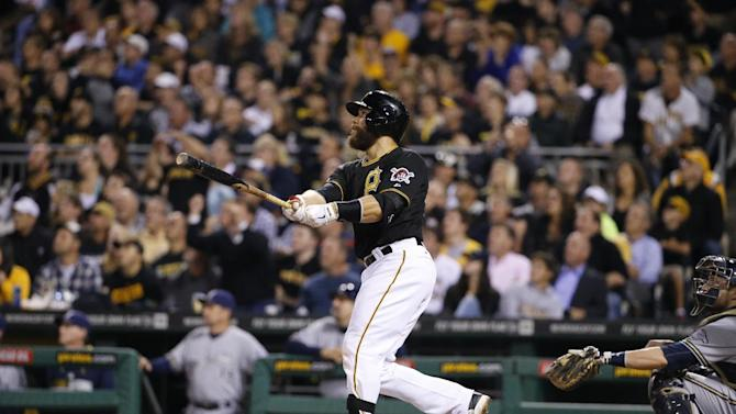 Pittsburgh Pirates' Russell Martin (55) hits a three-run home run off Milwaukee Brewers relief pitcher Jonathan Broxton during the eighth inning of a baseball game in Pittsburgh Friday, Sept. 19, 2014. (AP Photo/Gene Puskar)