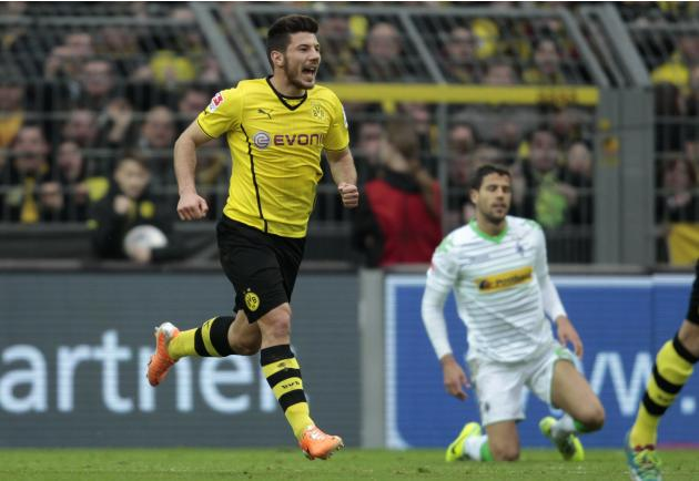 Borussia Dortmund's Milos Jojic celebrates a goal against Borussia Moenchengladbach during the German first division Bundesliga soccer match in Dortmund