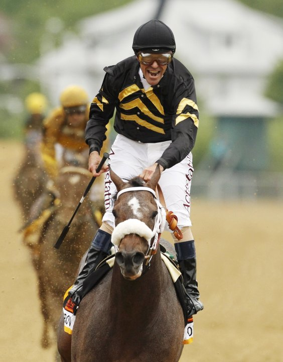 Jockey Stevens aboard Oxbow celebrates winning the 138th running of the Preakness Stakes at Pimlico Race Course in Baltimore