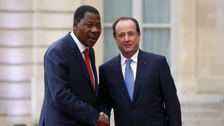 France's President Hollande greets Benin's President Thomas Yayi Boni in the courtyard of the Elysee Palace at the start of the Elysee Summit for Peace and Security in Africa, in Paris