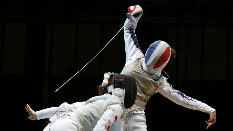 Oh of South Korea competes against Thibus of France in the women's team foil final match at the World Fencing Championships in Kazan