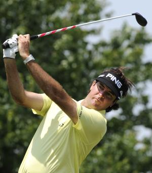 Bubba Watson watches his drive on the second hole during the third round of the Travelers Championship golf tournament in Cromwell, Conn., Saturday, June 22, 2013. (AP Photo/Fred Beckham)