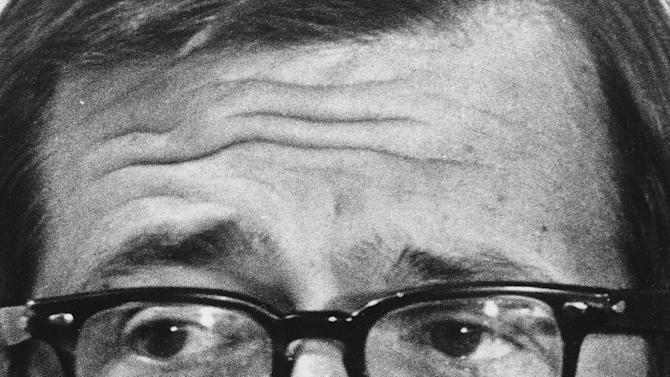 FILE - In this March 1, 1974 photo, former White House attorney Charles Colson talks to reporters after he was charged in the Watergate cover-up in Washington.  Colson, the tough-as-nails special counsel to President Richard Nixon who went to prison for his role in a Watergate-related case and became a Christian evangelical helping inmates, has died. He was 80. Jim Liske, chief executive of the Lansdowne-based Prison Fellowship Ministries that Colson founded, said Colson died Saturday, April 21, 2012.  (AP Photo/Charles Bennett)