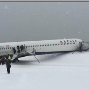 Delta plane skids off the runway at NYC's LaGuardia Airport