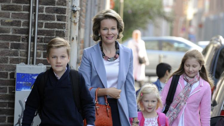 Belgium's Queen Mathilde walks with Princess Elisabeth, Princess Eleonore and Prince Gabriel on their first day of school at Sint-Jan Berchmans College in Brussels