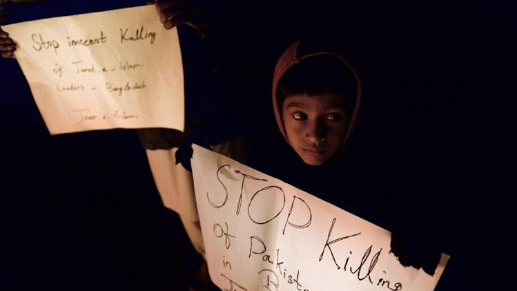 A boy takes part in a protest by activists of Jamaat-e-Islami Pakistan against the execution of Bangladeshi Islamist leader, in Islamabad on December 12, 2013