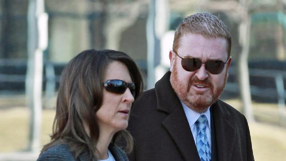 FILE - In this April 1, 2013, file photo, defense attorneys Daniel King, right, and Tamara Brady arrive at the courthouse for a hearing in the case of their client, Aurora theater shooting suspect James Holmes, in Centennial, Colo. King and Brady are chief trial deputies for the state public defender's office. (AP Photo/Brennan Linsley, File)