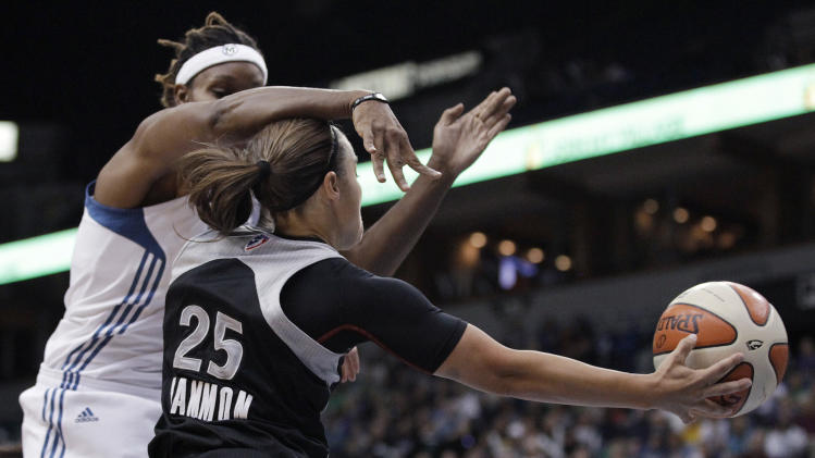 Minnesota Lynx forward Rebekkah Brunson fouls San Antonio Silver Stars guard Becky Hammon (25) as Hammon passes during the first half of Game 3 of a first-round WNBA playoff basketball series Tuesday, Sept. 20, 2011, in Minneapolis. (AP Photo/Stacy Bengs)