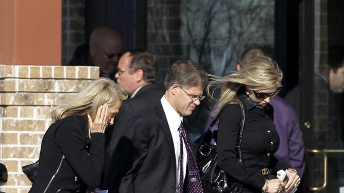 Kansas City Chiefs chairman Clark Hunt, center, leaves a funeral service for Kasandra Perkins at Ridgeview Family Fellowship Church Thursday, Dec. 6, 2012, in Blue Ridge, Texas. Perkins was shot and killed last Saturday by her boyfriend Jovan Belcher, a Chiefs football player. (AP Photo/Tony Gutierrez)