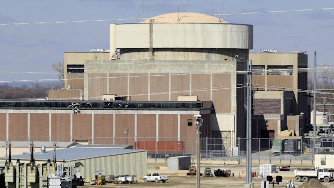 This March 26, 2013 photo shows the Fort Calhoun nuclear power plant in Blair, Neb. The power plant has been idle since April 2011 because of a series of safety problems and massive flooding by the Missouri River in 2011. (AP Photo/Nati Harnik)