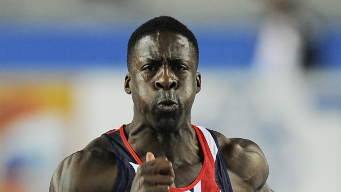 Britain's Dwain Chambers competes in a Men's 60m first round heat during the World Indoor Athletics Championships in Istanbul, Turkey, Friday, March 9, 2012.  (AP Photo/Martin Meissner)
