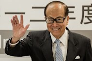 Asia's richest man Li Ka-shing waves during a press conference in Hong Kong on August 2, 2012. A Vietnamese property developer who started out making noodles in Ukraine joined Li for the first time on Forbes magazine's world's billionaires list Monday