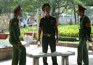 "Vietnamese soldiers at a public park near the Ho Chi Minh City People's Court. A court in southern Vietnam has jailed three bloggers for ""anti-state propaganda"", including one whose case has been raised by US President Barack Obama, at a brief but dramatic hearing"