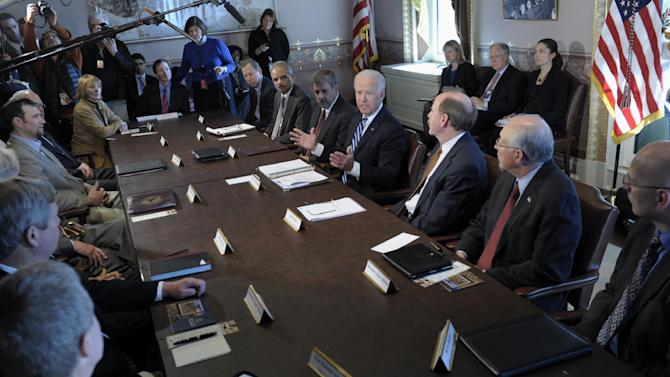 President Joe Biden, center, gestures as he speaks during a meeting with Sportsmen and Women and Wildlife Interest Groups and member of his cabinet, Thursday, Jan. 10, 2013,  in the Eisenhower Executive Office Building on the White House complex in Washington. Biden is holding a series of meetings this week as part of the effort he is leading to develop policy proposals in response to the Newtown, Conn., school shooting (AP Photo/Susan Walsh)