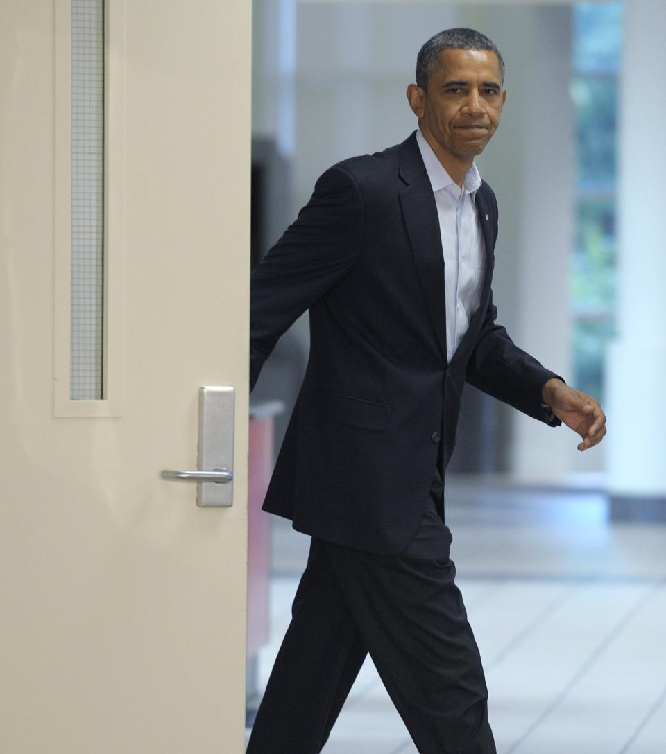 President Barack Obama walks out to make a statement from the University of Colorado Hospital in Aurora, Colo., Sunday, July 22, 2012, after visiting with families of victims of the movie theater shooting as well as local officials. (AP Photo/Susan Walsh)