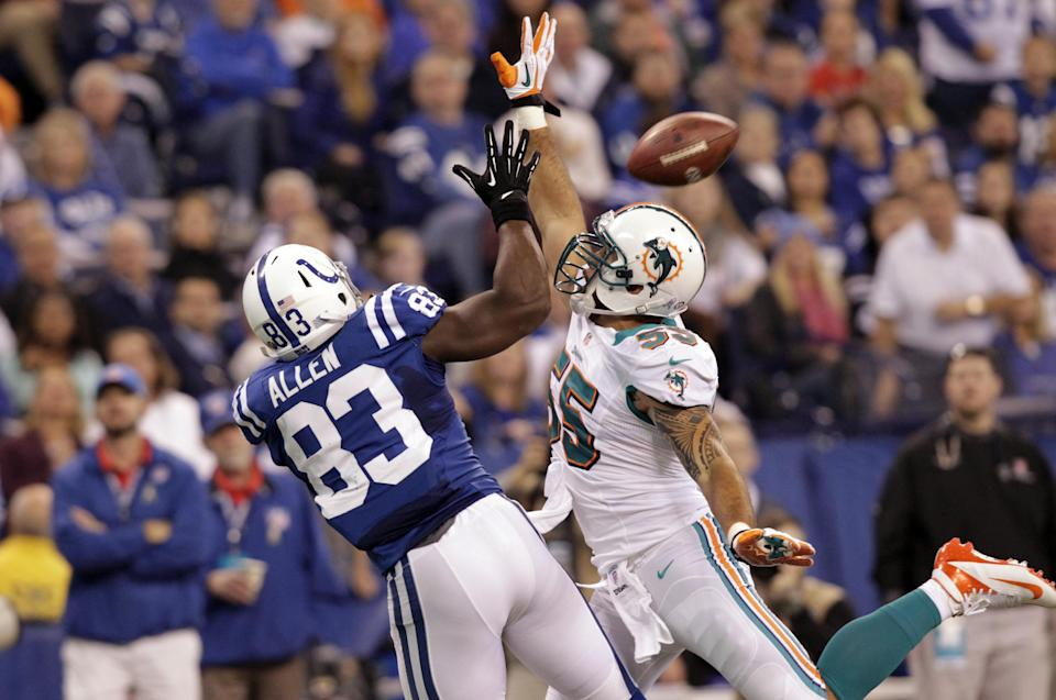 Miami Dolphins outside linebacker Koa Misi, right, breaks up a pass to Indianapolis Colts tight end Dwayne Allen during the first half of an NFL football game in Indianapolis, Sunday, Nov. 4, 2012. (AP Photo/AJ Mast)