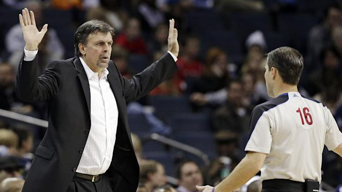 Houston Rockets head coach Kevin McHale, left, argues a call with referee David Guthrie, right, during the second half of an NBA basketball game in Charlotte, N.C., Monday, Jan. 21, 2013. Houston won 100-94. (AP Photo/Chuck Burton)