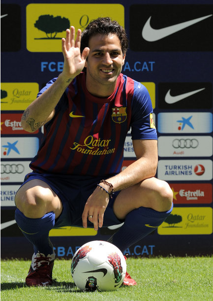 Barcelona's new player Cesc Fabregas waves to supporters during his official presentation at the Camp Nou's stadium in Barcelona, after signing a new contract with the Catalan club, on August 15, 2011. Arsenal captain Cesc Fabregas has completed his move to Barcelona by signing a five-year contract with his boyhood club. AFP PHOTO/LLUIS GENE (Photo credit should read LLUIS GENE/AFP/Getty Images)