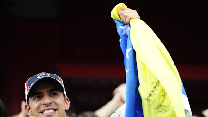 Williams's Pastor Maldonado, from Venezuela celebrates with his team after his victory at the Spanish Grand Prix at Catalunya racetrack in Montmelo, near Barcelona, Spain, Sunday, May 13, 2012. Maldonado become the sport's first Venezuelan winner, while Williams' 114th triumph was its first since the 2004 Brazilian GP. (AP Photo/Manu Fernandez)