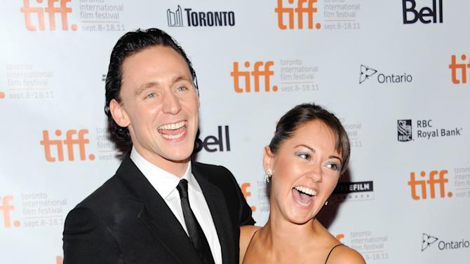 "Actor Tom Hiddleston and wife Susannah Fielding attend a gala screening for the film ""The Deep Blue Sea"" during the Toronto International Film Festival on Sunday, Sept. 11, 2011, in Toronto. (AP Photo/Evan Agostini)"