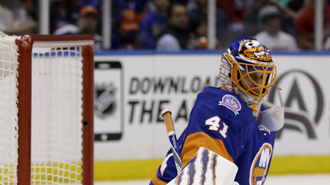 New York Islanders goalie Jaroslav Halak makes a save against the Washington Capitals during the first period of Game 3 of a first-round NHL hockey playoff series Sunday, April 19, 2015, in Uniondale, N.Y. (AP Photo/Seth Wenig)