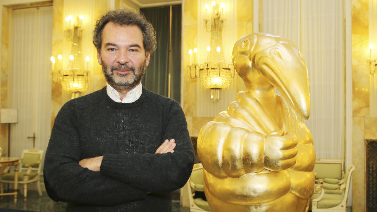 Moncler chairman Remo Ruffini poses after presenting its initial public offering for the admission of the company's shares to listing on the Milan's exchange market, in Milan, Italy, Monday, Dec. 2, 2013. Moncler, an Italian fashion house known for its down jackets, is launching an initial public offering this month in what Milan's main stock exchange hopes will boost its plan to become an international hub for luxury goods company listings. (AP Photo/Antonio Calanni)