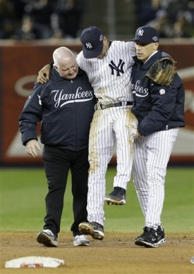 Trainer Steve Donohue, left, and Yankees manager Joe Girardi, help Derek Jeter off the field. (AP)