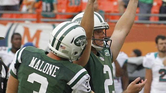 New York Jets kicker Nick Folk (R) celebrates with teammate Robert Malone after kicking the game-winning overtime field goal to defeat the Miami Dolphins during their NFL football game in Miami, Florida (Reuters)