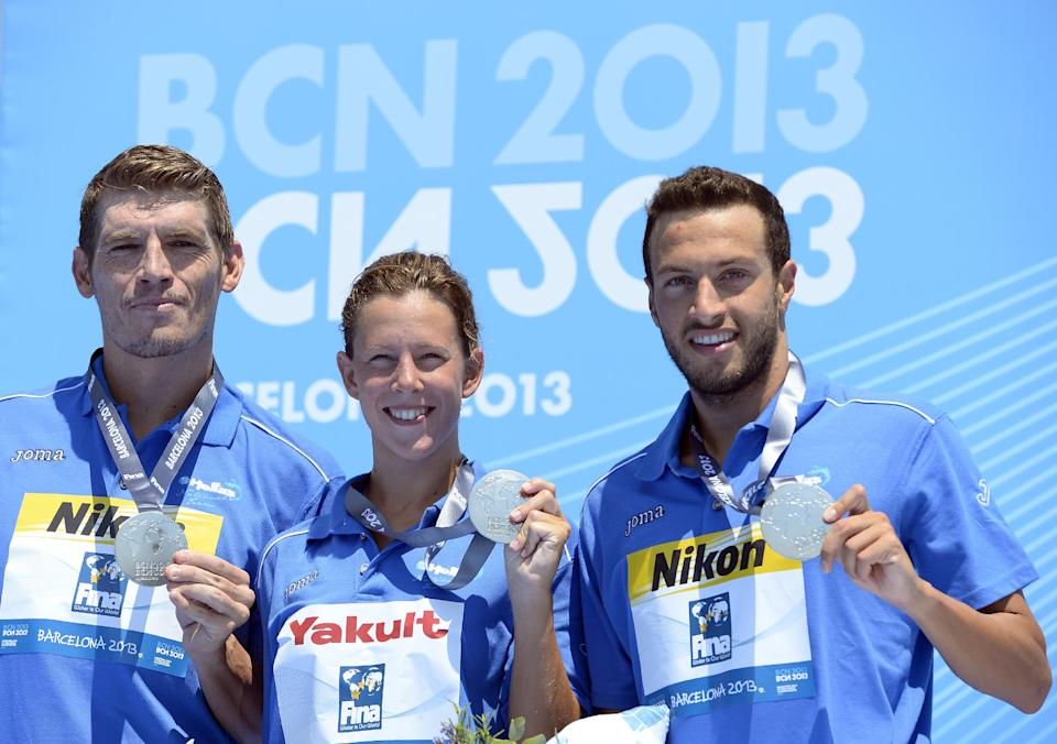 Silver medalists from Greece Spyridon Gianniotis, left, Kalliopi Araouzou, center, and Antonios Fokaidis hold up their medals following the 5km team event open water swimming competition at the FINA Swimming World Championships in Barcelona, Spain, Thursday, July 25, 2013.(AP Photo/Manu Fernandez)