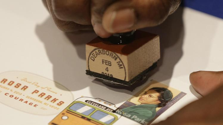 A postal service employee prepares to cancel the Rosa Parks' 100th birthday commemorative postage stamp at The Henry Ford museum in Dearborn, Mich., Monday, Feb. 4, 2013.   The museum held a 12-hour celebration of the 100th anniversary of Parks' birth.  (AP Photo/Carlos Osorio)