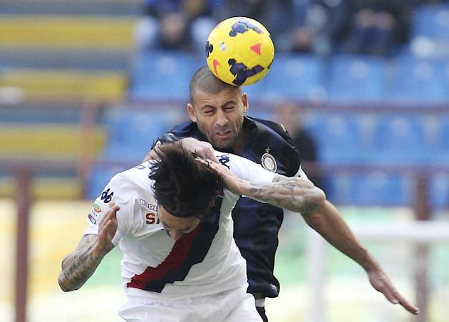 Inter Milan Argentine defender Walter Samuel, top, jumps for the ball with Cagliari forward Mauricio Pinilla, of Chile, during the Serie A soccer match between Inter Milan and Cagliari at the San Siro