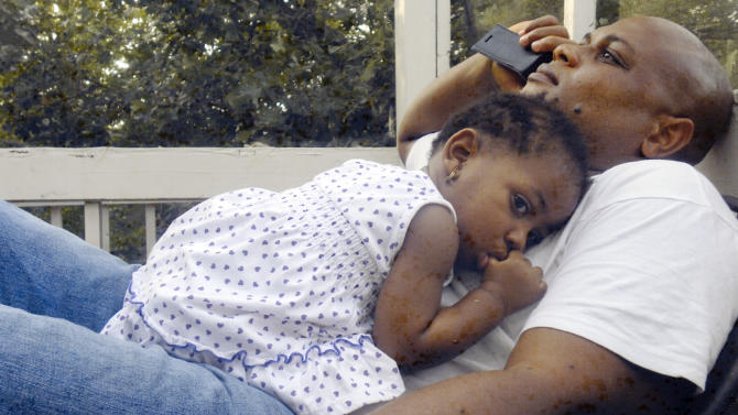Patrick Sawyer is shown with his daughter Ava at their home in Coon Rapids