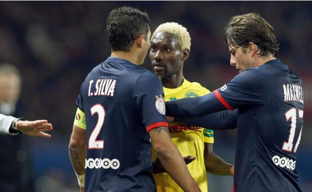 Paris St Germain's Thiago Silva and Maxwell speak with FC Nantes' Ismael Bangoura during their French Ligue 1 soccer match at the Parc des Princes Stadium in Paris