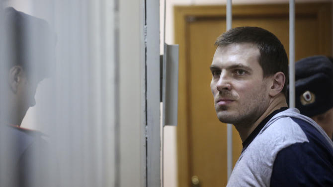 Maxim Luzyanin, 36, attends his trial on charges that he attacked riot police during a massive rally against Russian President Vladimir Putin at the Zamoskvoretsky district court, Moscow, Russia, Friday, Nov. 9, 2012. The Zamoskvoretsky district court in Moscow said Thursday that 36-year-old gym owner Maxim Luzyanin assaulted police and pelted them with pieces of asphalt when scuffles broke out at a May opposition rally in central Moscow, sentencing him to four and half years in jail. (AP Photo/Yevgeny Feldman, Novaya Gazeta)
