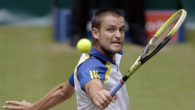 Mikhail Youzhny of Russia returns  the ball  to Switzerland's Roger Federer  during the final of the   Gerry Weber Open ATP  tennis tournament in Halle,  Westphalia, Germany, Sunday, June 16, 2013. (AP Photo/Martin Meissner)