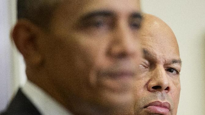 Homeland Security Secretary Jeh Johnson listens at right as President Barack Obama speaks in the Roosevelt Room of the White House in Washington, Wednesday, Nov. 25, 2015. Obama briefed the public on the nation's homeland security posture heading into the holiday season, following meeting with his national security team. (AP Photo/Pablo Martinez Monsivais)