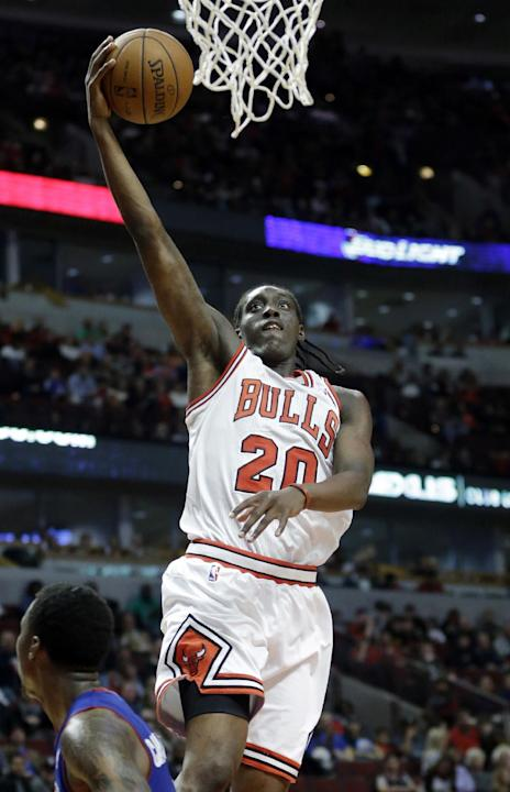 Chicago Bulls forward Tony Snell drives to the basket during the second half of an NBA preseason basketball game against the Detroit Pistons in Chicago on Wednesday, Oct. 16, 2013. The Bulls won 96-81