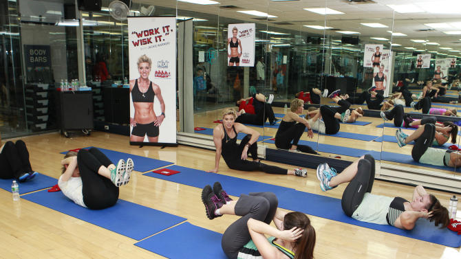 IMAGE DISTRIBUTED FOR WISK DEEP CLEAN - Celebrity trainer Jackie Warner leads the Wisk Deep Clean's gym class at the New York Health and Racquet club on Wednesday, Jan. 09, 2013 in New York City. (Mark Von Holden/AP Images for Wisk Deep Clean)