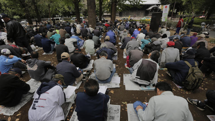 Unemployed people wait for meal which will be distributed by volunteers at a park in Tokyo, Tuesday, Oct. 30, 2012. Jobless rate figures for September offered little encouragement, as the government reported the seasonally adjusted unemployment rate was 4.2 percent in September, unchanged from August. (AP Photo/Itsuo Inouye)